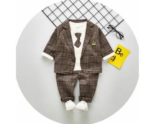 Нарядний костюм хлопчикові коричневий 3646